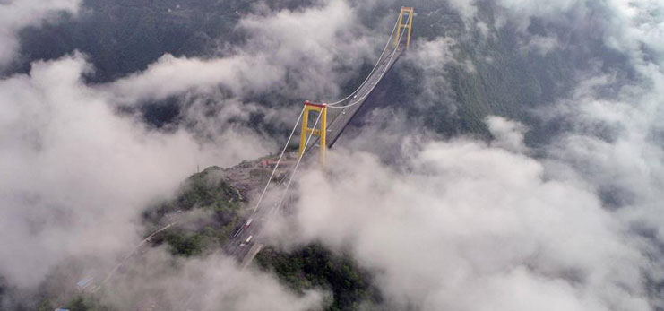 Bridge enveloped by clouds and fog in Enshi, central China's Hubei