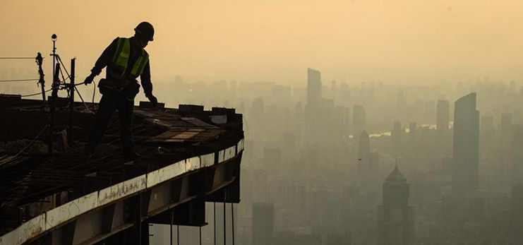Constructors work at construction site of high rise building in Wuhan
