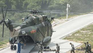 PLA holds military drill in HK, locals invited to observe