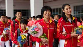 Chinese Olympic delegates arrive in Macao