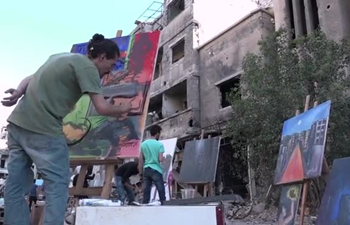 Syrian artists add color to ruins through meaningful paintings